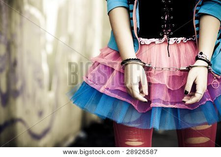 Handcuffs on young girl in modern dressing