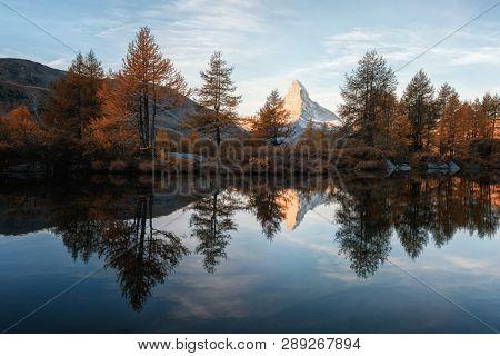 Incredible colorful sunset on Grindjisee lake with Matterhorn Cervino peak in Swiss Alps. Zermatt resort location, Switzerland. Landscape photography