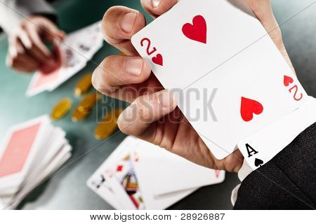 Cheating while playing poker with hiden Ace under the sleeve