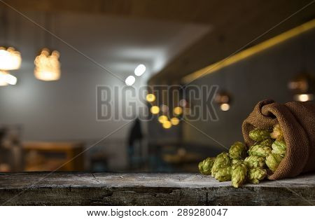 Beer Brewing Ingredients Hop In Bag And Wheat Ears On Wooden Cracked Old Table. Beer Brewery Concept
