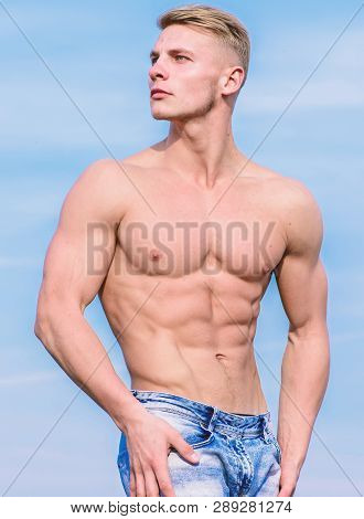Sportsman muscular torso posing. Man muscular torso stand confidently. Sport and bodycare. Muscular masculine guy look confident. Man sexy muscular bare torso stand outdoor blue sky background poster