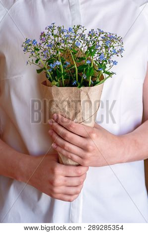 A Bouquet Of Forget-me-nots In The Hands Of The Girl, Close-up. Woman Holding A Bouquet With Forget-