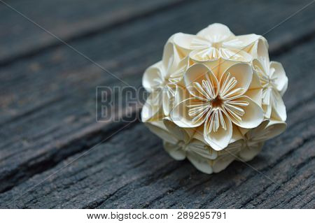 Yellow Origami Kusudama Flower On Wooden Background