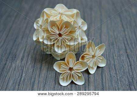 Yellow Origami Kusudama Flower On Wooden Background
