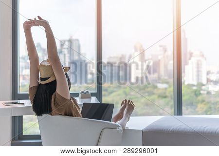 Work And Travel Lifestyle Relaxation And Healthy Work-life Balance With Young Asian Working Woman Ta