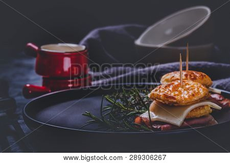 Sandwiches From Puff Pastry Dough With Ham And Cheese With Herbs