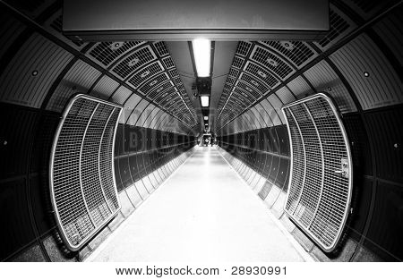 Cylindric tunnel for pedestrians, monochrome toned.