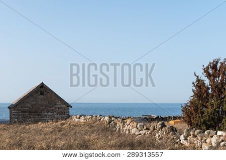Traditional Fishing Cabin Built Of Limestone At The Swedish Island Oland In The Baltic Sea
