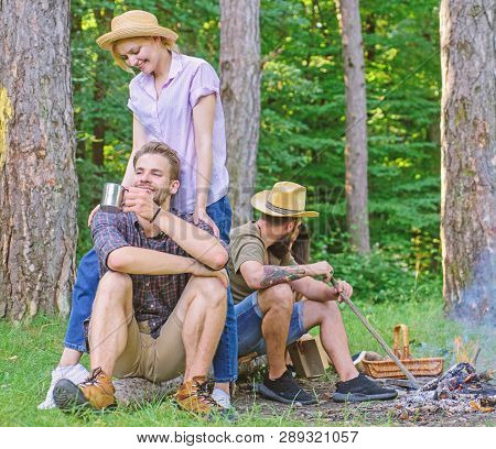 Friends Relaxing Near Campfire After Day Hiking Nature Background. Company Friends Enjoy Relaxing To