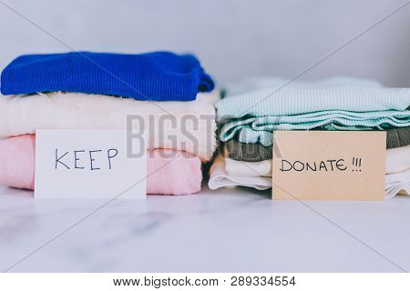 Piles Of Tshirts And Clothes Being Sorted Into Keep Discard And Donate Categories
