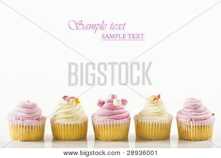 Pretty pink cupcakes in a row with space for text