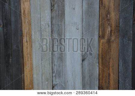 Colored Gray Brown Wooden Texture From Old Boards In The Wall Of The Fence