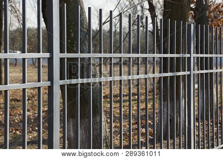 Part Of A Black Metal Fence Made Of Iron Rods