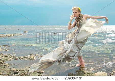 Sea Nymph On The Ocean Blowing In A Shell