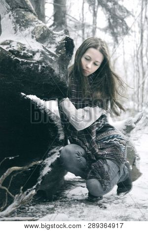 Girl Lost In The Snowy Winter Forest