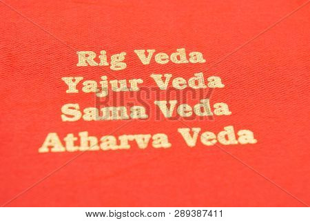 Maski,karnataka,india - March 13,2019 :the Four Types Of Holy Vedas Printed On Red Textured Paper.