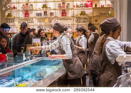 Rome, Italy - January 11, 2019: People in the Venchi chocolate shop in Rome. Venchi is an Italian gourmet chocolate manufacturer with 75 shops around the world.