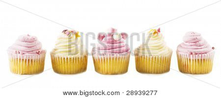 Pink and cream cup cakes in a row