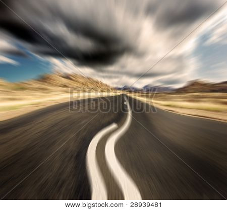 Motion showing image of a road wobble under heavy cloud