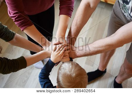 Stack Of Family People Hands - Father With Children On Light Brown Wooden Texture Laminate Floor Bac