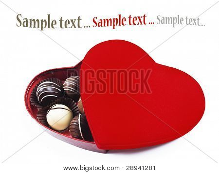 a Red heart shaped box of chocolates on a white background with space for text