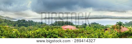 Panoramic view of Lake Arenal in central Costa Rica under dramatic cloudy sky