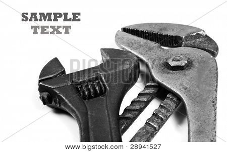 Close up of different old used spanners on a white background with space for text