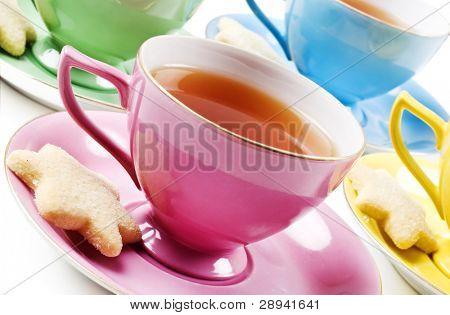 Colorful antique tea cups with tea