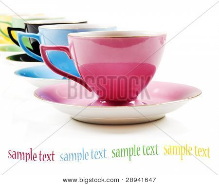 Colorful antique tea cups with tea