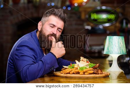 Businessman Formal Suit Sit At Restaurant. Man Received Meal With Fried Potato Fish Sticks Meat. He