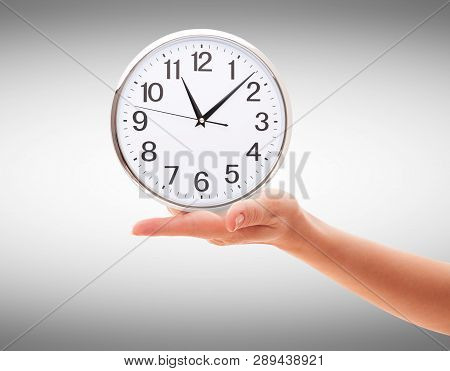 Human Hand Holding Clock Time Isolated On White