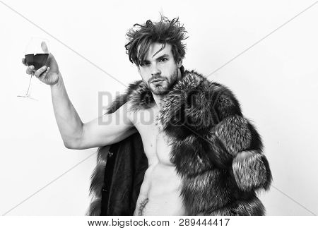 Guy Attractive Rich Posing Fur Coat On Naked Body. Rich Athlete Enjoy His Life. Fashion And Pathos.