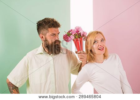 Hipster Bearded Give Bouquet Flowers Girl Excuse Gesture. Man With Beard Apologyes Woman. Couple In
