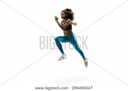 Young African Woman Running Isolated On White Studio Background. One Female Runner Or Jogger. Silhou