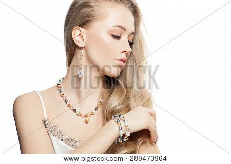 Closeup Portrait Of Pretty Blond Hair Woman In Gold Jewelry Bijou Isolated On White Background