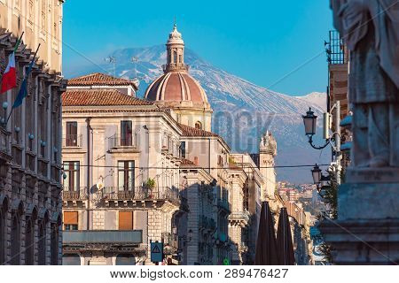 Dome Of Church And The Main Street Via Etnea, Volcano Etna On The Background, Catania , Sicily, Ital
