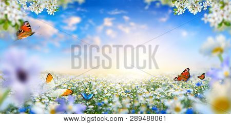 Dreamland Fantasy Landscape With A Meadow Covered By Spring Flowers And Butterflies Flying Towards T