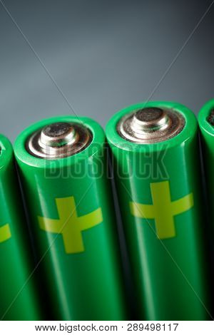 Four batteries on a metal table.