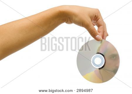 A woman's hand holding a CD in it is visible the reflection of a man whit headphones on his had. poster
