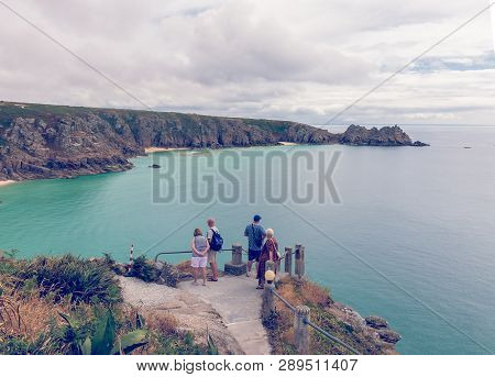 Porthcurno, Cornwall, England - July 24, 2018: Cliffs And Sea In Cornwall, England, Uk, Taken From T