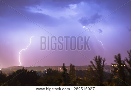 Night Lightning Storm Over City In Blue Dramatic Lighting