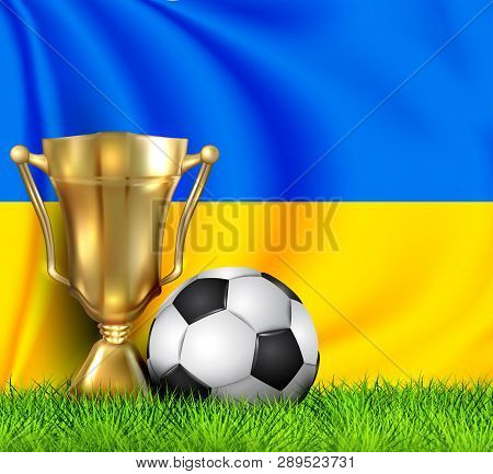 Golden Realistic Winner Trophy Cup And Soccer Ball Isolated On National Ukraine Flag. National Team
