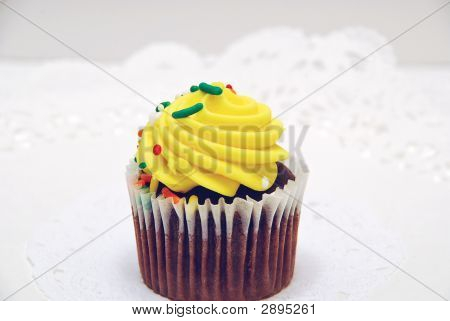 Chocolate Cupcake On White Doily