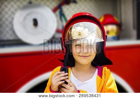 Girl In Fireman Helmet