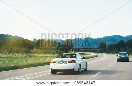 Schiltach, Germany - Jun 10, 2018: German Highway With Luxury Bmw Convertible Cabriolet Car Driving