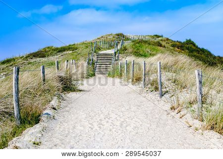 Empty Sandy Path With Stairs Through Dunes Leading To The Beach. Summer. Vacation. Travel. Path To U