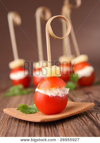 finger food, tomato stuffed with cheese