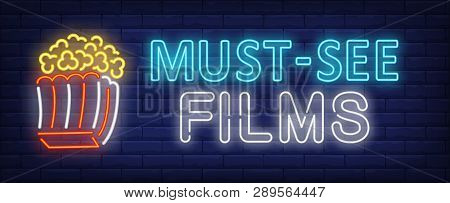 Must-see Films Neon Text With Popcorn Paper Box. Cinema And Entertainment Concept, Advertisement Des