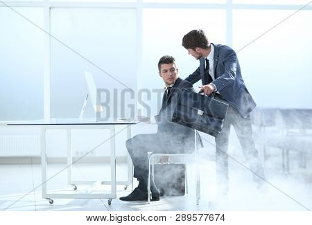 two businessmen during the beginning of the fire