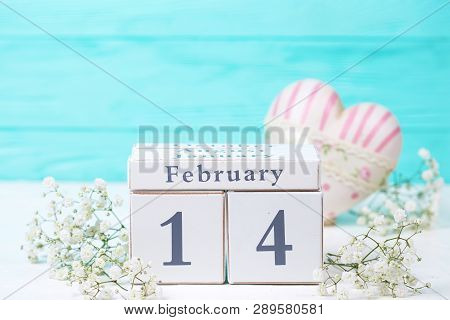 Calendar, White Flowers, Pink Decorative Heart On White  Background Against Turquoise Wall. Selectiv